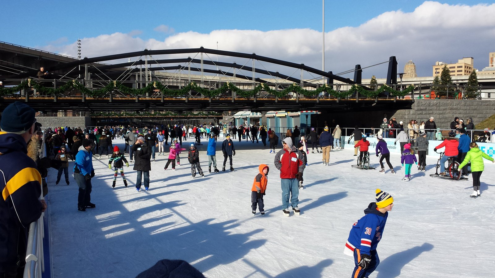 The rink at Canalside Buffalo is like a day at the beach on a cold but sunny January afternoon. Skaters were not deterred by the long line to get in or the chilly wind.