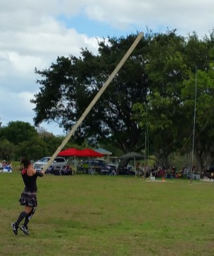 A woman throws the caber during the Southeast Florida Highland Games. (Craig Davis/Craigslegz.com)
