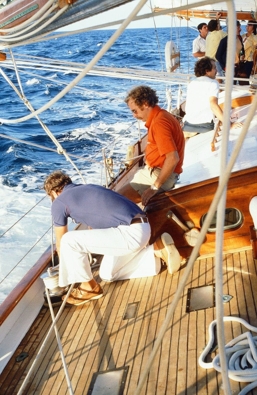 Jimmy Buffett watches as Ticonderoga's owner Ken MacKenzie trims a sail during the 1980 Fort Lauderdale to Key West Race.
