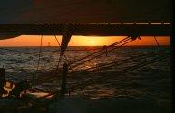 Sun sets as Ticonderoga sails off the Upper Keys in the 1980 Fort Lauderdale to Key West Race. (Craig Davis/Craigslegztravels.com)