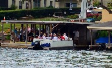 Tour boats have been taking tourists on the hour-long tours of the lakes at Winter Park, Fla, since 1938. (Craig Davis/Craigslegztravels.com)