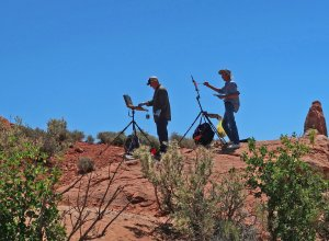 Two artists are perched for a view to paint the Skyline Arch at Arches National Park. (Craig Davis/Craigslegztravels.com)
