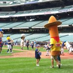 Sausage mascots play ball with kids on Brewers Family Day 2017 at Miller Park. (Craig Davis/Craigslegztravels.com)