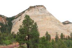 The 900-foot high Checkerboard Mesa is a famous landmark on the Zion-Mt. Carmel Highway. (Craig Davis/Craigslegztravels.com}