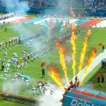 The Miami Dolphins take the field amid fire and smoke at Hard Rock Stadium. (Craig Davis/CraigslegzTravels.com