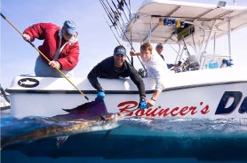 Catching a sailfish provides a photo opportunity before the fish is released alive. (Courtesy Bouncer Smith)