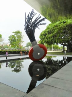 Typewriter Eraser, Scale X is a 19-foot sculpture and a massive ficus tree are distinguishing features outside the Norton Museum of Art in West Palm Beach, Fla. (Craig Davis/Craigslegztravels.com)