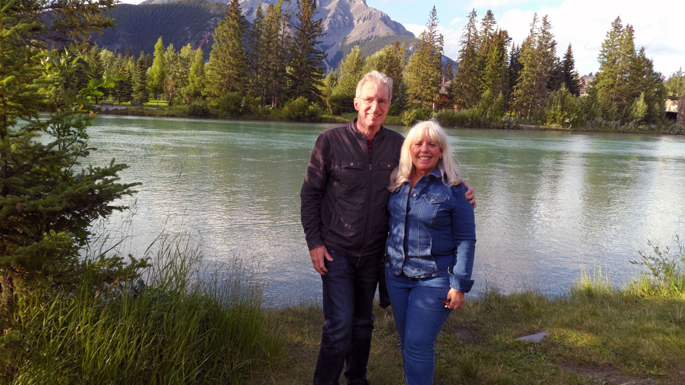 Craig and Fran Davis by the Bow River in Banff, Alberta. (craigslegztravels.com)