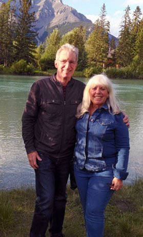 Craig and Fran Davis at the Bow River in Banff, Alberta. (Craigslegztravels.com)