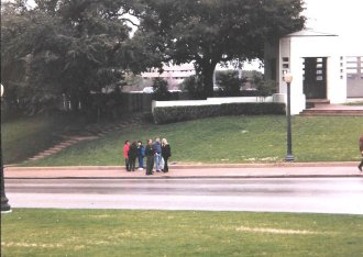 Visitors to Dealey Plaza gather by the spot on Elm Street where President Kennedy was fatally wounded adjacent to the Grassy Knoll. (Craig Davis/craigslegztravels.com)