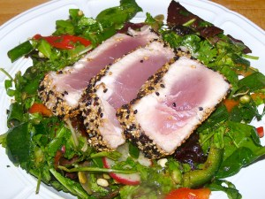 Sesame crusted seared tuna over mixed greens salad