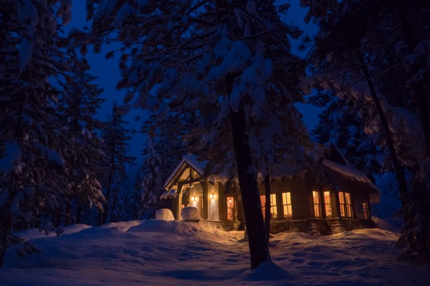 Moonlit cabin in the snow