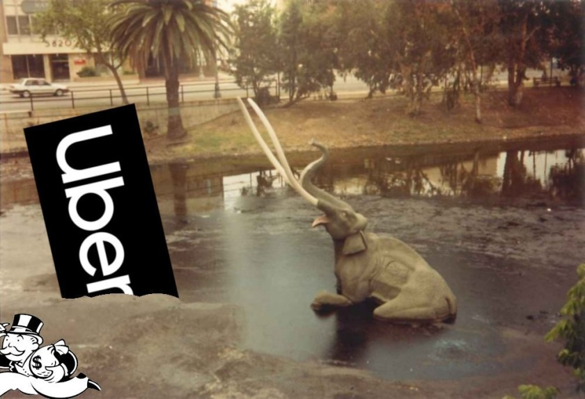 The sinking mammoth exhibition at the La Brea Tar Pits; next to the doomed pachyderm is the Uber logo, also mired in the tar. Monopoly's Rich Uncle Pennybags is partially in the bottom left corner of the frame, running away with a bag of money.