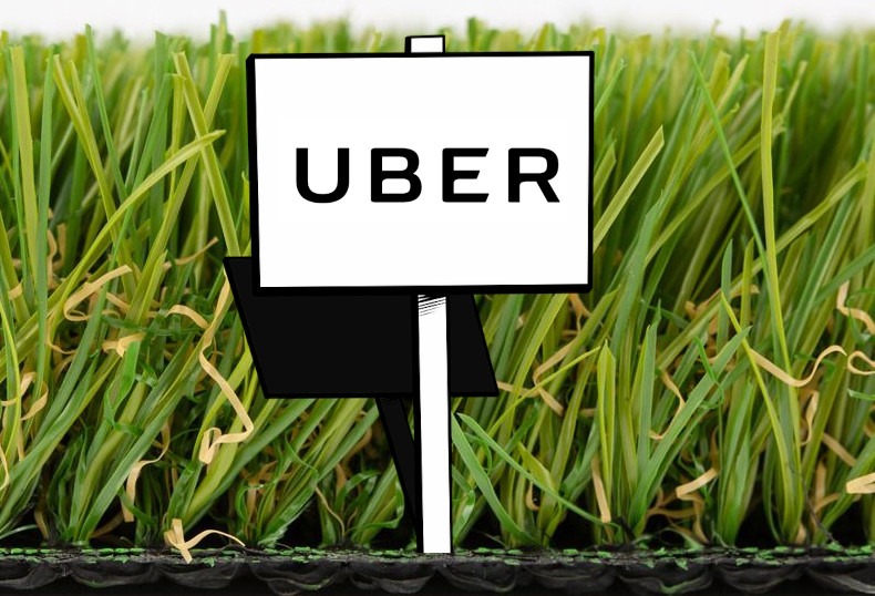 A slab of astroturf sprouting a sign reading 'Uber.'