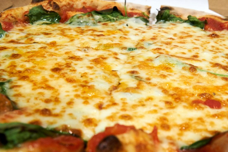 Berlin chef bakes cheesiest pizza in the world with 111 different types of cheese-1