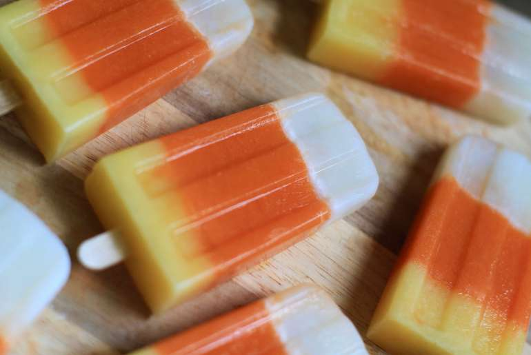 Healthy candy corn popsicles are a perfect Halloween sweet treat.