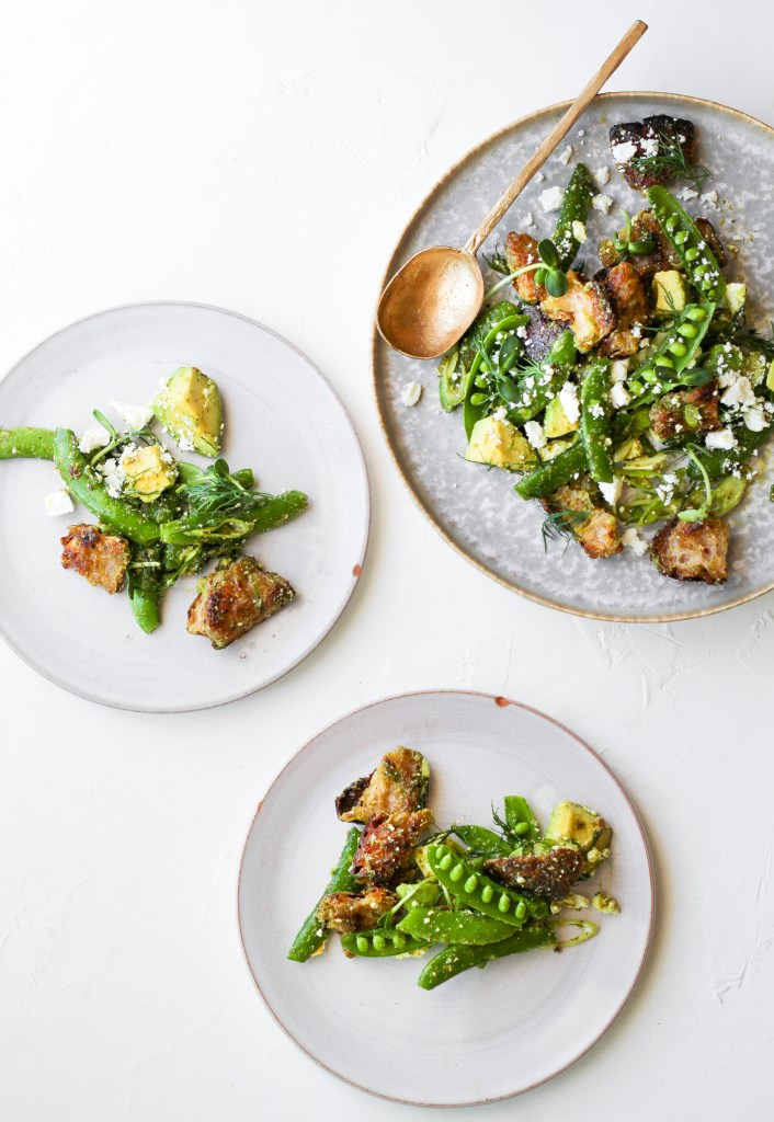 snap pea and avocado salad with toasted bread and feta cheese