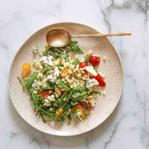 Corn and Arugula Salad with Tomatoes and Blue Cheese