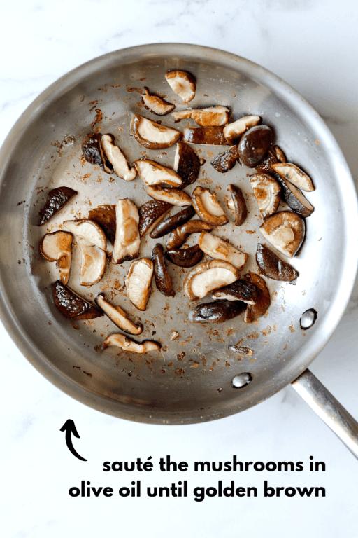 Shiitake mushrooms sautéing in a pan