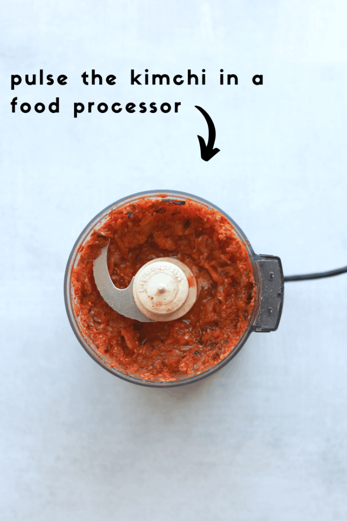 kimchi being pulsed in a food processor