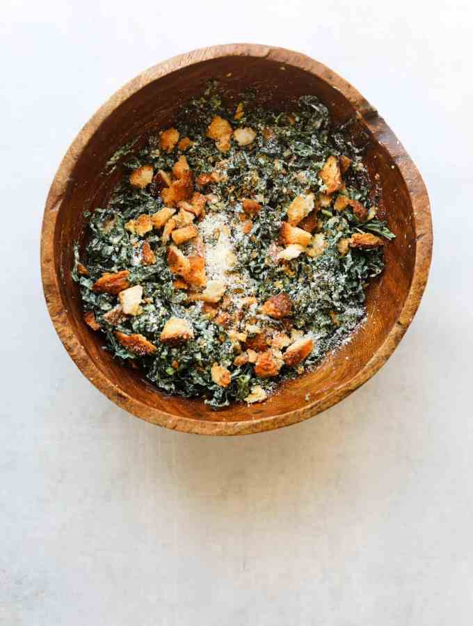 The Perfect Kale Caesar Salad in a wooden bowl
