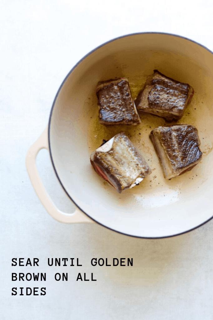 short ribs searing in a pan