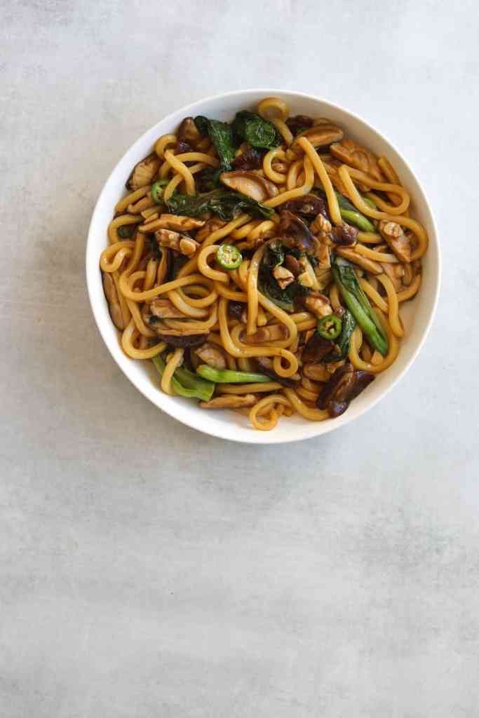 Udon Noodle Stir Fry in a white bowl