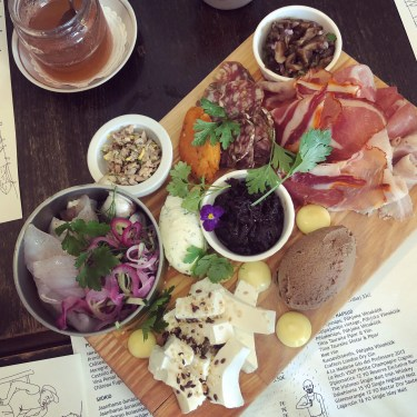 Charceuterie board with cheeses, meats, fish, and liver pate