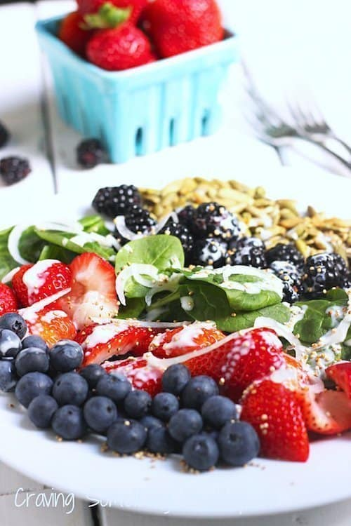 This Very Berry Spinach Salad is the best way to enjoy fresh seasonal berries. Don't skip the tangy citrus yogurt dressing and popped quinoa for extra crunch! @Craving Something Healthy