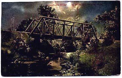 View of Pennsylvania Railroad bridge at night in 1910