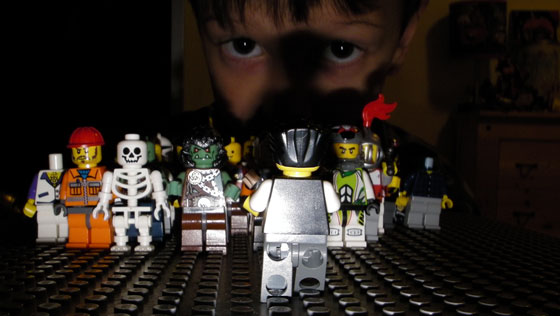 My son demonstrates his Lego® creativity by building a scene of a guy being chased by a bunch of other zombie like creatures.