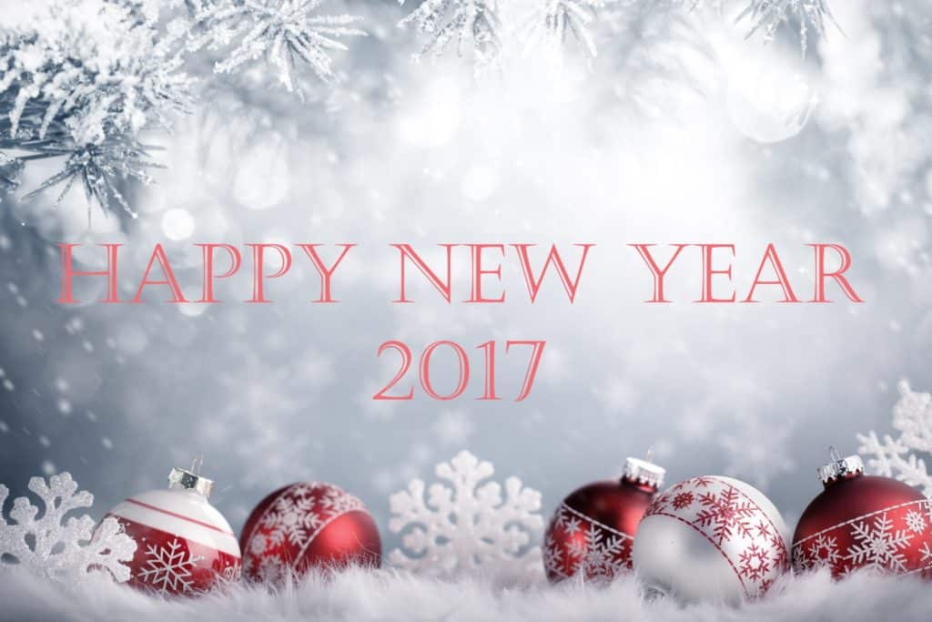 Happy New Year 2017 with snowfall and red balls