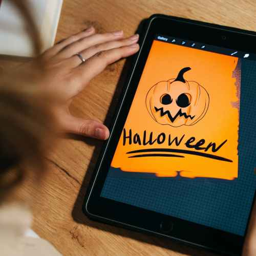 drawing a halloween illustration on a tablet