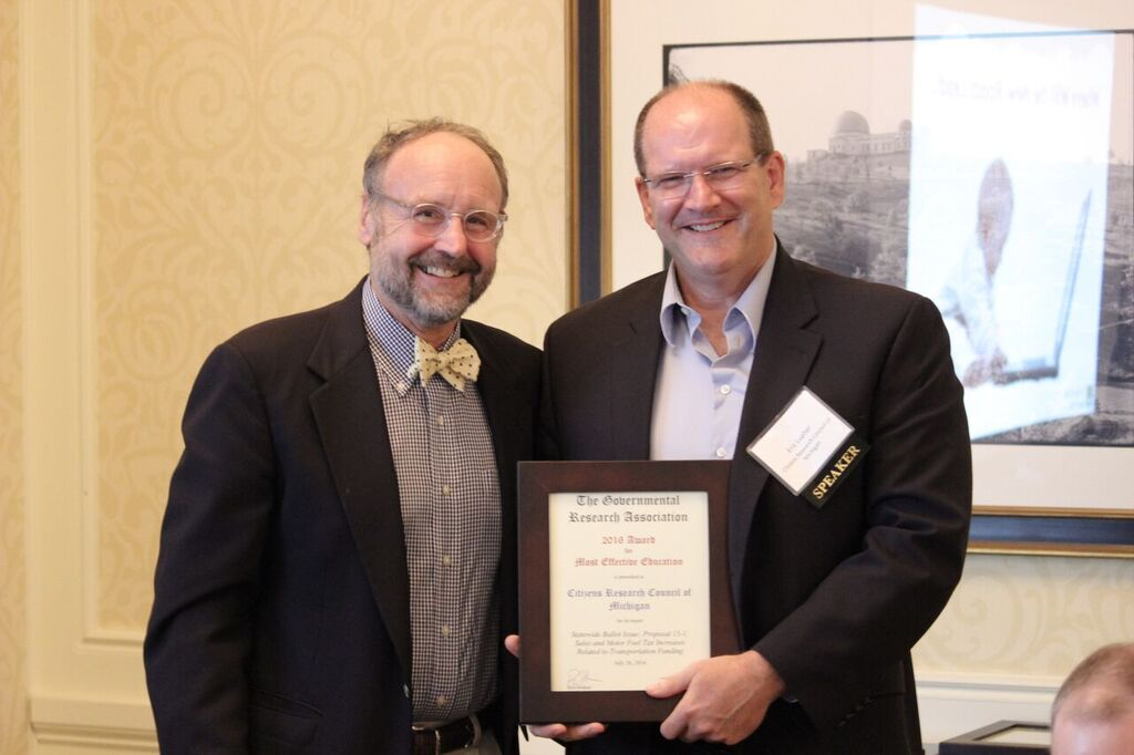 Citizens Research Council President Eric Lupher receives the 2016 Award for Citizens Education from GRA Treasurer Kriss Sjoblom