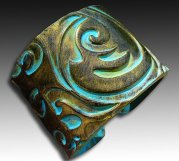 http://www.etsy.com/listing/98633595/old-gold-and-patina-polymer-clay-cuff?ref=usr_faveitems