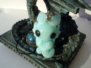 http://www.etsy.com/listing/116726231/polymer-clay-ice-dragon-charm?ref=sr_gallery_29&ga_search_query=polymer+clay&ga_view_type=gallery&ga_ship_to=US&ga_ref=auto3&ga_explicit_scope=1&ga_search_type=handmade