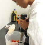 Nicholas masterfully works the hand blender on the gazpacho.