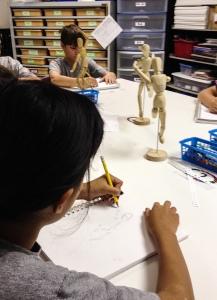Students sketching mannequin - Sketchbook Assignment