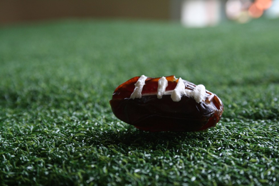 Stuffed Date Footballs (vegan, gluten free) - These sweet stuffed footballs are perfect for game day. Sure to please and impress your guests!