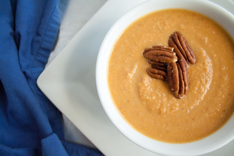 Sweet Potato Soup with Toasted Pecans birds eye view close up.