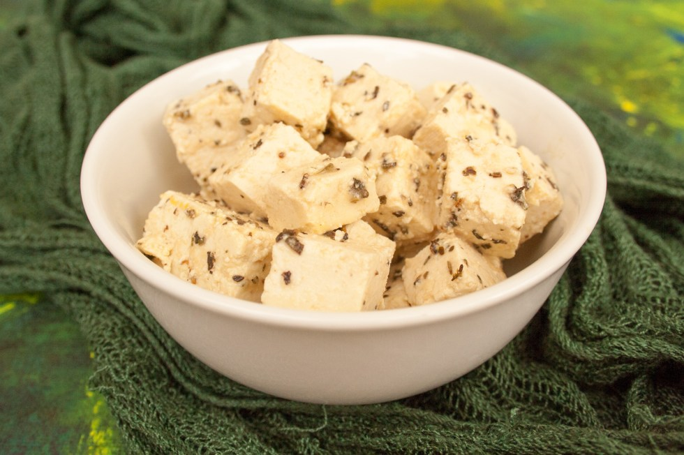 "Tofu Feta - This vegan feta will have you wondering why you ever wanted the dairy version! It is marinated in herbs and vinegar to give it a wonderful tangy, ""cheesy"" flavor."