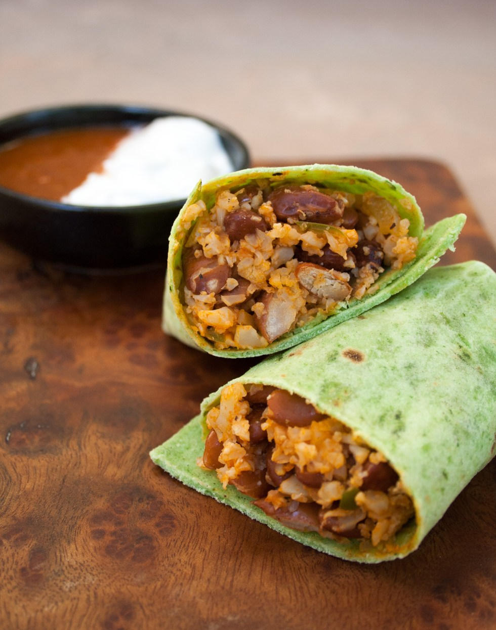 Bean and Mexican Cauliflower Rice Burritos - These spicy vegan gluten free burritos are great for a weeknight because they are super easy to throw together.