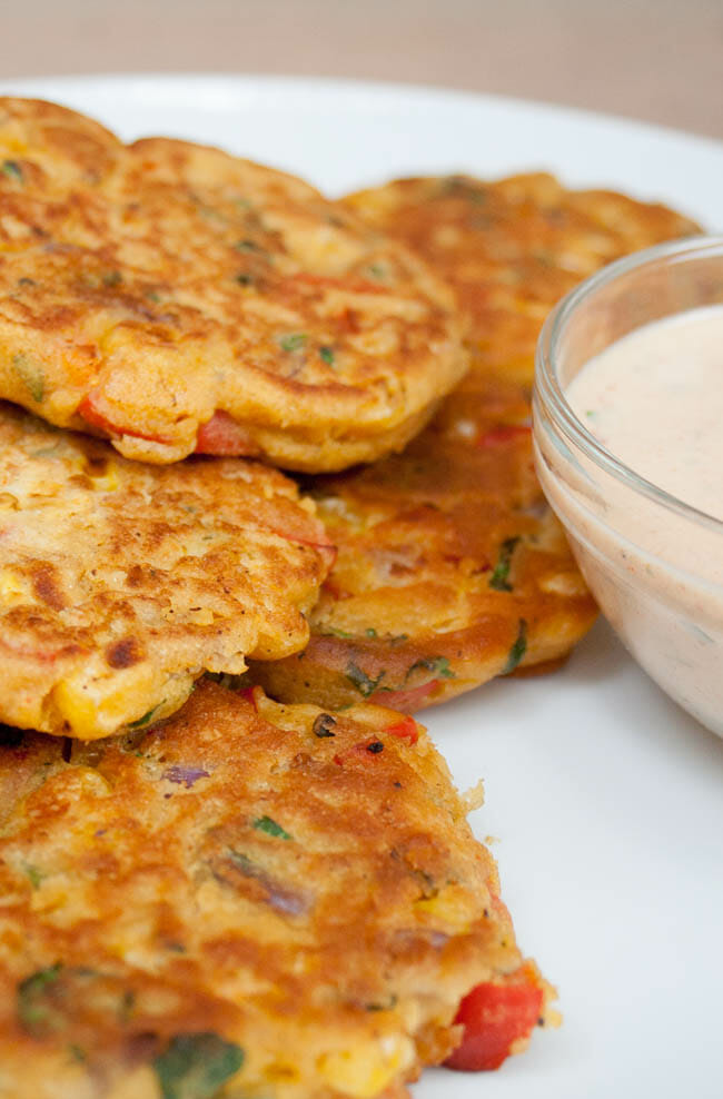 Vegetable Fritters vertical close up with Vegan Chipotle Ranch Dressing.
