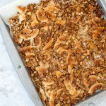 Coconut Granola (vegan, gluten free) - This recipe will whisk you away to the tropics! It is packed with coconut flavor, easy to make and cheaper than store bought!