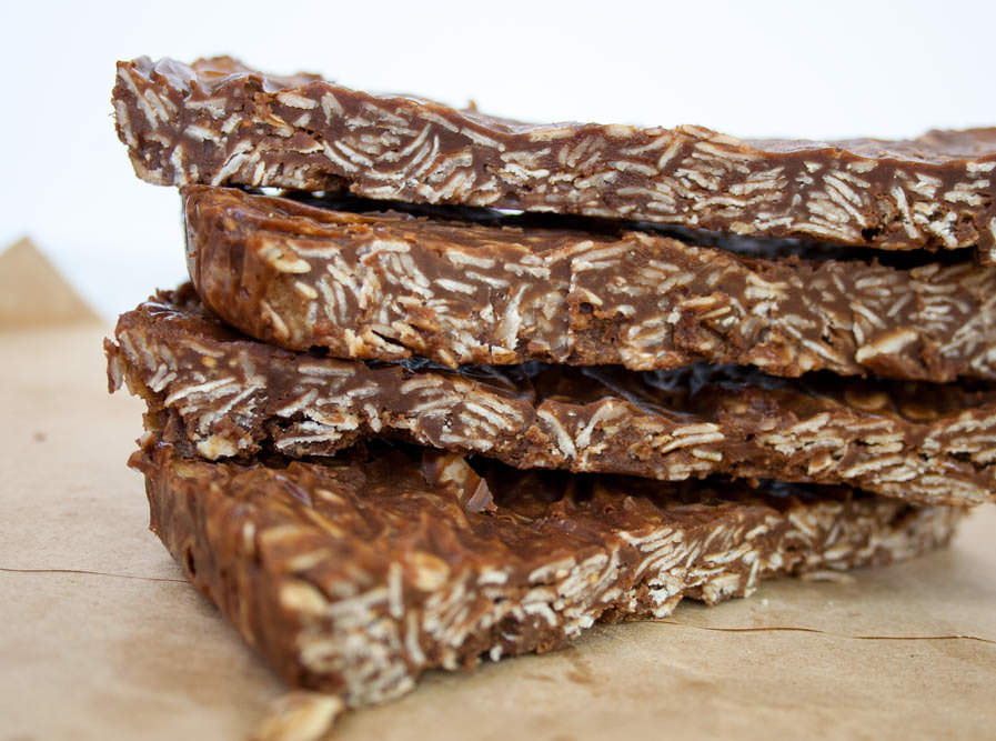 Vegan Chocolate Peanut Butter Granola Bars close up of four bars stacked on top of each other.