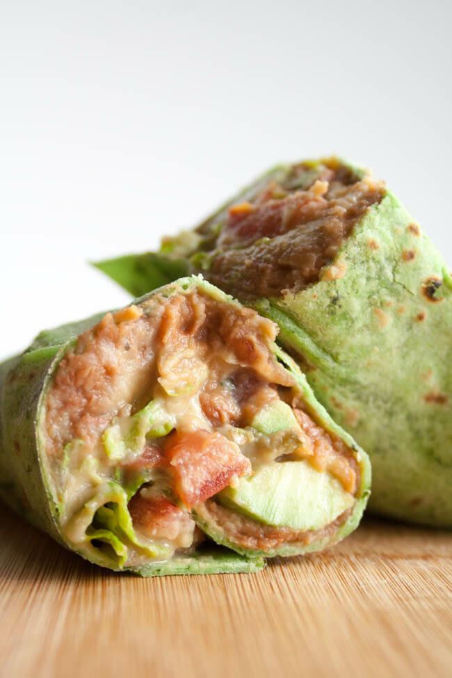 Vegan Refried Bean Burrito with Jalapeño Cilantro Hummus close up.