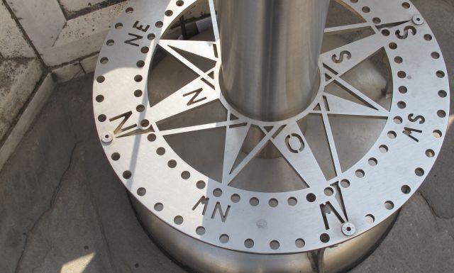 Base of Telescope shaped like compass