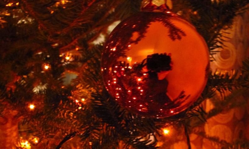Reflection of red-lit orb ornament