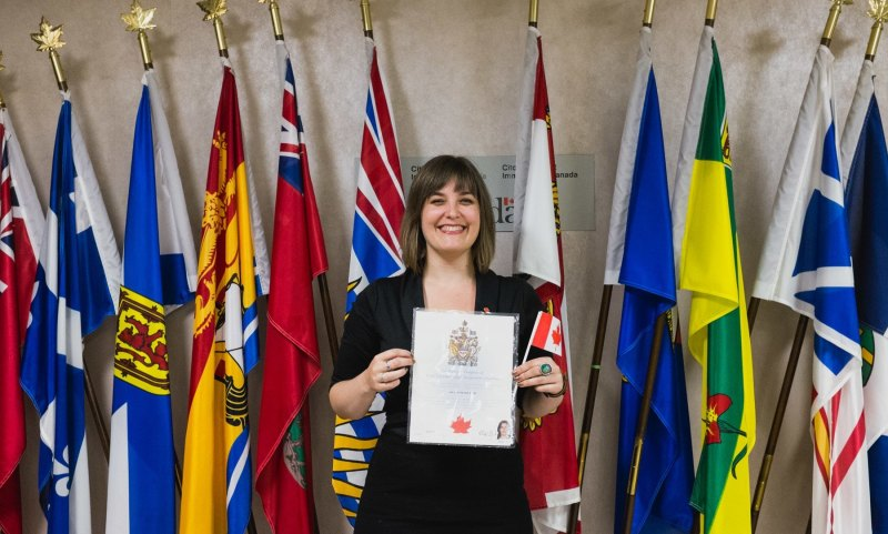 Me in front of a bevy of flags at the Canadian Citizenship ceremony