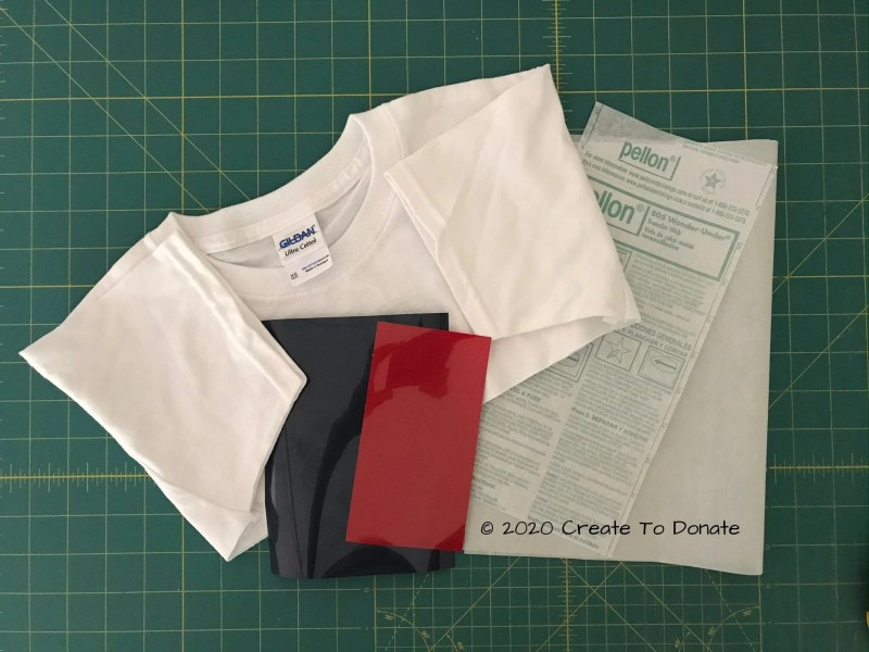 Materials for a custom patch include the top cutoff from a 100% cotton shirt,, fusible web, and HTV.